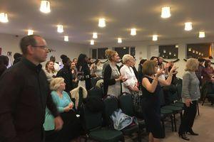 Congregation singing and Praising God