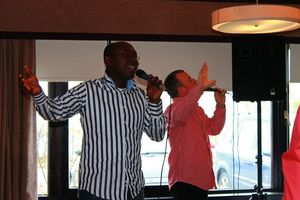 Two Men singing and lifting hands