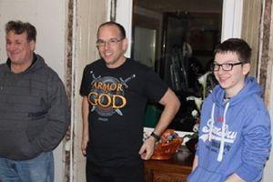 Three men standing talking