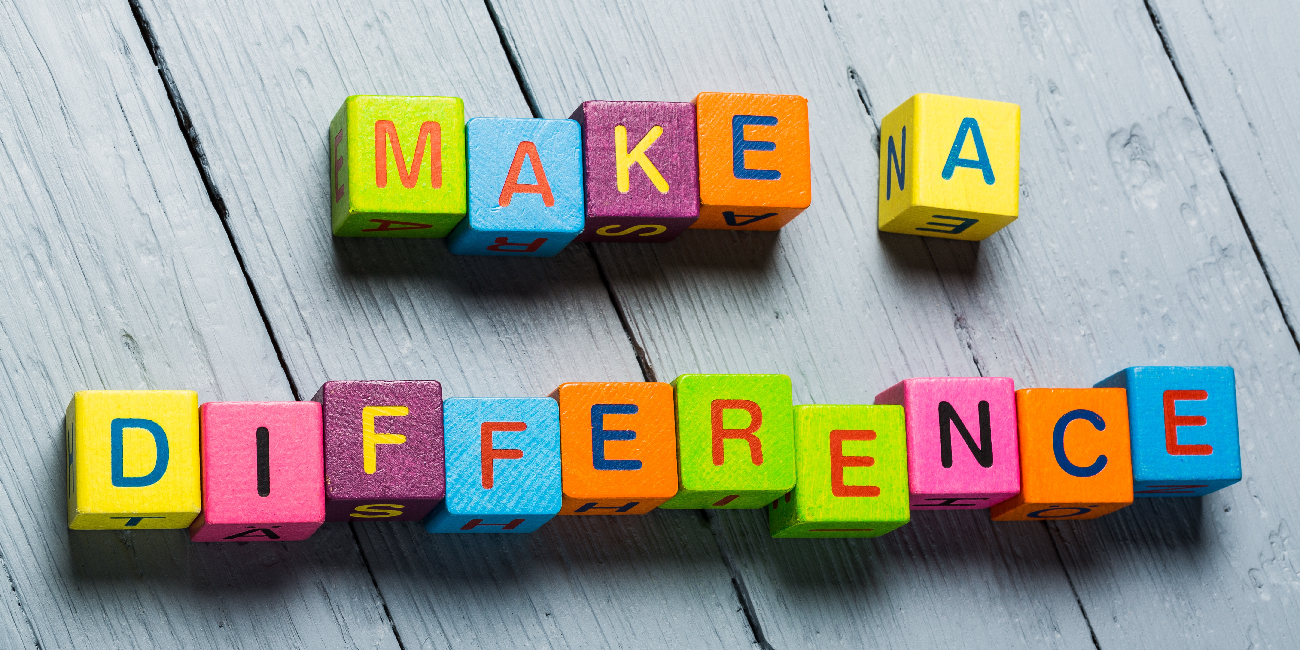 wooden blocks spelling 'make a difference'
