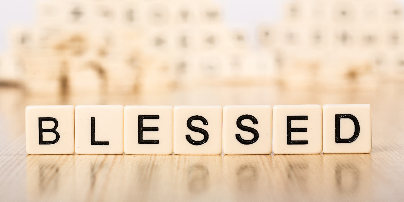 image of scrabble letters spelling the word 'blessed'