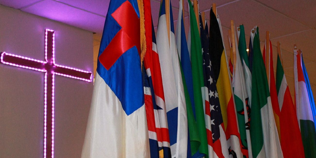 International Flags beside cross