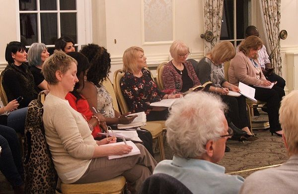 Group of Delegates Listening To Speaker