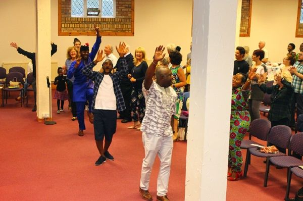 Men and Women Praising God